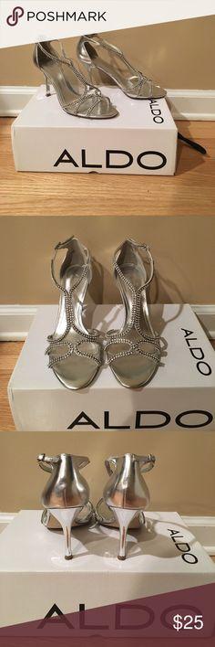 "Aldo Silver Rhinestone Heels size 7 (37) 👠 Silver rhinestone heels from Aldo are a size 7 (37). These beautiful heels were worn once. Heel Height-3.5"" Aldo Shoes Heels"