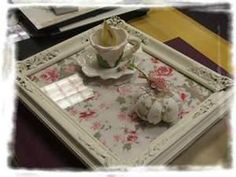 I am currently using old frames and adding pretty paper to make beautiful trays that look like this!