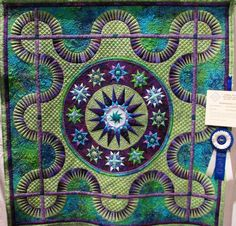 "JdJ Quilt pattern ""Surprisingly Red"" done in shades of blue, green, purple...AWESOME!!"