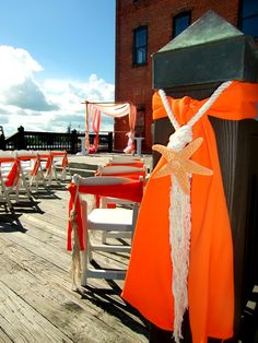 Deck wedding in July 2012 for Linnsey and Luis. Orange and white themed weddings. Beach themed wedding. The RiverRoom