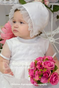 Sheer allover floral embroidered christening dress with sequin trim. Matching bonnet included. Available at Christian Expressions 245 Phenix Ave Cranston, Rhode Island and online http://www.christian-baby.com/pd-mindy-christening.cfm