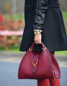 pretaportre:    Maje coat, J Brand jeans coated in Bourbon, Gucci handbag, and Cara Spiked, J Crew, Michael Kors bracelets.