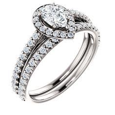 halo pear shape engagment ring  #wwww.nzjewellers.co.nz #wwww.nzdiamonds.co.nz #hand made engagment rings #wholsale diamonds #g.i.a