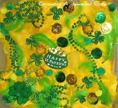 st pattys day sensory . yellow and green feathers coins necklaces shamrocks