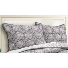 This is a soft geometric medallion design with classic grey paired with muted lilac. These cotton shams are machine washable and made of 100 percent cotton.