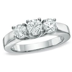 Three round diamonds stand alone, needing no accompaniment, a melody so magnificent that any harmony would distract from its brilliance.