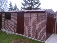 Sectional tudor brown brick Apex garage Concrete Garages, Brown Brick, Prefab, Tudor, Garage Doors, Outdoor Decor, Home Decor, Decoration Home, Room Decor