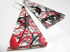 Purchased from a stall in Covent Garden in 1985, these hand-made earrings distill the look of a decade into sharp, Perspex triangles.  Drizzled with enamel paint on both sides – but not the edges - there's a slight parallax at work in those glossy squiggles that draws you in. Very close. More at The Vintage Copywriting Blog