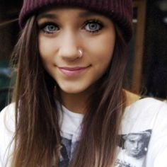 How come she looks cute in hats?  And with nose rings?   Not fair.