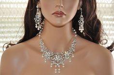 Bridal Jewelry Set,Bridal Statement Necklace,Pearl,Rhinestone Necklace,Vintage Style,Swarovski Crystal,Bridal Necklace and Earring Set. $269.00, via Etsy.