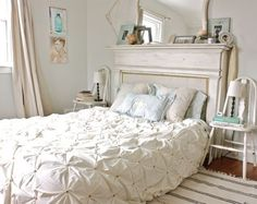 Style + Serenity. Chairs as bedside tables, mantle as a headboard and tufted bedding.