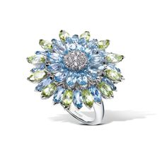 Created in the Asprey workshops, the Double Daisy Ring uses pavé diamonds, peridot and topaz, set in 18ct white gold
