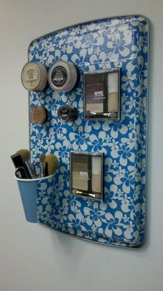 Magnetic makeup board I made using a cookie sheet, duct tape and magnets for less than $15.00