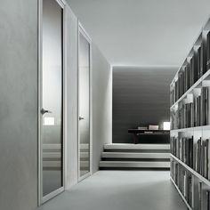 """""""Quadrante"""" Door by Rimadesio.  Aluminium jamb, grey etched glass panel."""