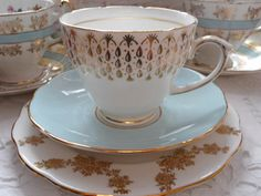 Elegant mismatched vintage bone china tea set trio: duck egg blue and gold, perfect for a special tea party!
