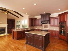 """""""Traditional Tuesday"""" Photo: Large island kitchen with high ceilings and a wood hood."""