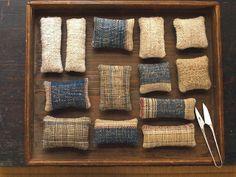 cocoon / nishikawa harue - pincushion:  nettle + hand-spun hemp + hand-spun silk + natural dyes / hand-woven wool batting