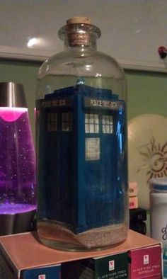 Forget a ship in a bottle: I want a TARDIS in a bottle! (It was cut into tiny pieces & assembled inside the bottle. Amazing!)