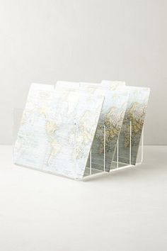 Love these map covered folders - anthropologie .... Could do this with old bucks county maps to salvage used manilla folders