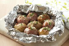 Grilled New Potato Packet recipe - Get it all done on the grill with this foil-packet technique. New potatoes are infused with tangy dressing and savory Parmesan for a no-mess, delectable side dish. Potato Dishes, Potato Recipes, Vegetable Recipes, Chicken Recipes, Foil Pack Meals, Foil Dinners, Grilling Recipes, Cooking Recipes, Healthy Recipes