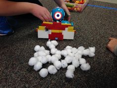 "Coding projects for kids: Add a LEGO ""snowplow"" to Dash and see how fast he can clear the cotton balls"