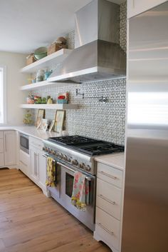 Eclectic Kitchen Photos Design, Pictures, Remodel, Decor and Ideas - page 14.    I like the idea of putting the microwave in a base cabinet.