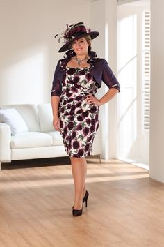 """<div><span+style=""""font-style:+italic;+font-weight:+bold;"""">Below+the+knee+fitted+dress+with+short+sleeves+and+matching+bolero.</span><span+style=""""font-style:+italic;+font-weight:+bold;"""">The+purple-aubergine+colouring+to+this+dress+gives+a+classic,+feminine+feel,+whilst+the+shape+of+the+dress+gives+a+flattering,+elegant+look.</span></div>  <div><span+style=""""font-style:+italic;+font-weight:+bold;""""><br+/></span></div>  <div>  <div…"""
