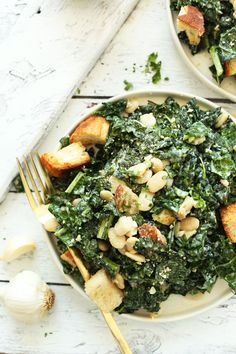 A 30-minute kale salad with lemon-herb white beans, garlic croutons, and a creamy tahini dressing. A hearty, flavorful, plant-based side or entrée.