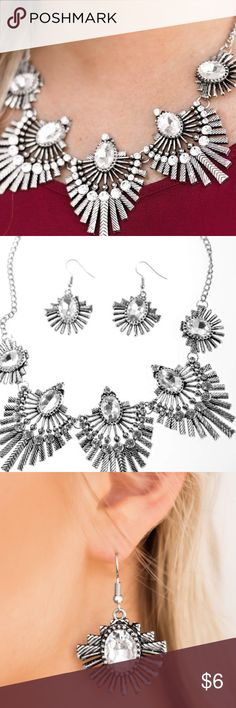 Miss You Niverse Necklace Set! Textured metal bars flare out from a mesmerizing gem, creating a fringe of fanning frames. Sprinkled with matching white rhinestones, the dazzling display falls just below the collar for a sassy finish. Features an adjustable clasp closure.  Sold as one individual necklace. Includes one pair of matching earrings. Jewelry Necklaces