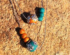 Jade and gold hand made polymer clay and metal beaded, double stranded leather necklace