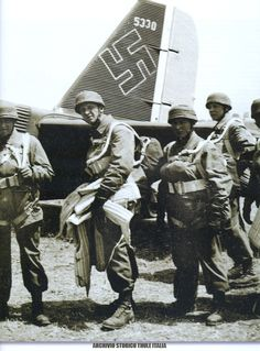 German paras boarding for Crete, 1941. They suffered such atrocious losses that Hitler banned them from parachuting into combat again.