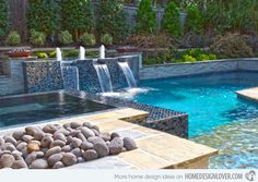 Stacked stone wall with waterfalls make this pool something ...