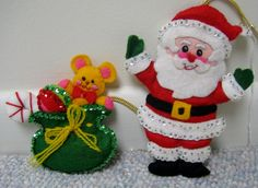 Vintage Christmas Felt Ornaments... a lot of these felt ornaments would make great embellishments. Just cut out the front piece (no stuffing or back so that it lays flat), decorate, and add to your card and scrapbook LO.