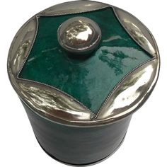 A vintage Moroccan pottery jar signed Safi S. P. T. on bottom. This jar is done in a stunning malachite green color with applied silver to bottom edge