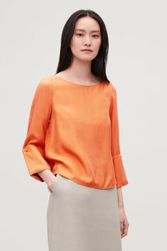 2d86f41b48b53 Model side image of Cos changeable silk blouse in orange