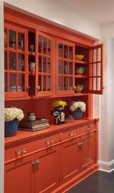 love this orangey-red built-in cabinet - Benjamin Moore Dark Salmon. Try Chalk Paint® decorative paint by Annie Sloan in Barcelona Orange...maybe add a little Emperor's Silk for a custom color?