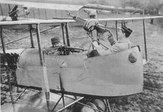 French pilot and observer demonstrate arc of machine gun fire in early pusher planes.