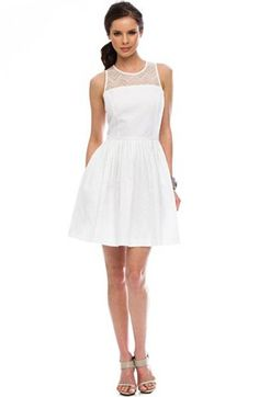 I saw a girl today wearing this Armani Exchange Lace Dress. It was so crisp and clean and it shimmered and shined in the light. I thought I was in dress heaven, its that perfect.