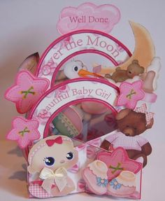 Over the Moon Girl Cascade Card Kit  on Craftsuprint designed by Dawn Hill - made by Jane Wells - Printed onto photo card, this endearing baby girl cascade kit was assembled following the very clear instructions. I layered all the images using 3d foam pads and added a little cream bow for baby! There are many elements to this kit and I didn't use all of them, so plenty left over to make up another card! Value for money and a delight to make! - Now available for download!