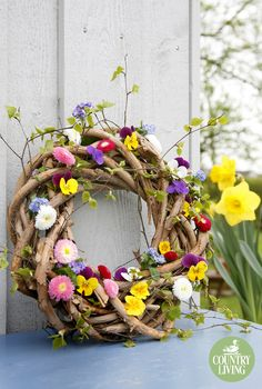 Ornamental daisies, violas and sprigs of forget-me-nots entwined with fresh green foliage turn a twig wreath into an eye-catching display that sings spring is here. Place outside as a temporary decoration for a party or keep the flower stems hydrated using individual small plastic tubes (available from florists) filled with water and wired in place. Alternatively, use narcissi, which will last well outdoors.