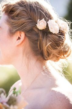 bride2be:    a loose bun with fresh flowers Photography by anitamartinphotography