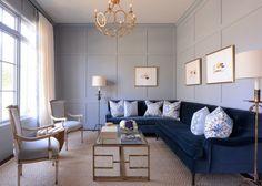 + light fixture, navy sofa, light blue chairs