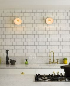 Trend Spotting: Gold and Brass in the Kitchen | Apartment Therapy  Love the sink - how it's level with the countertop!