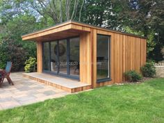 An extend classic garden room supplied with an impressive wide aluminium bi-folding door section! Gym Shed, Shed Office, Jacuzzi, Cedar Cladding, Cedar Garden, Classic Garden, Garden Buildings, Backyard, Patio
