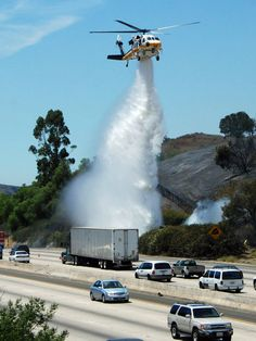 LA County Fire Copter 15 helping to put out a fire along a freeway