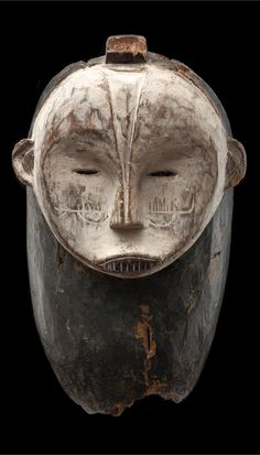 Africa | Ngontang mask from the Fang people of Gabon | Wood, kaolin and pigment