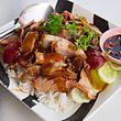 THAI: Khao mu krop mu daeng in Nong Khai; Slices of mu krop (crispy pork) and mu daeng (red roast pork) served on rice, and often covered with a sticky soya and/or oyster-sauce based sauce. Very often, a clear soup, boiled egg, cucumber, and spring onion is served on the side. Sliced chillies in Chinese black vinegar and dark soy sauce are provided as a condiment for this dish.