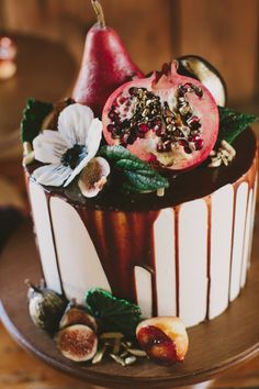 Decadent fig and pomegranate topped fall wedding cake: http://www.stylemepretty.com/2015/11/18/elegant-autumn-barn-wedding-in-maine/ | Photography: Henry + Mac - http://henryandmac.com/