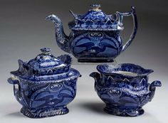 """Northeast Auctions - THE COLLECTION OF CHESTER CREUTZBURG AND DAVID MARTIN - PART ONE. 3/5/16.  Lot 4: BALD EAGLE,' RARE STAFFORDSHIRE DARK BLUE TRANSFER-PRINTED SUGAR BOWL AND COVER, TEAPOT AND A COVER, AND ANOTHER SUGAR BOWL, UNKNOWN MAKER, EARLY NINETEENTH CENTURY.  Estimated Price: $1,000 - $1,500. Realized: 720 (600).   Description: Both the teapot and the sugar (lacking a cover) are unlisted. Heights 6 1/2, 5 7/8 and 4 1/2 inches. Provenance: The first, """"The Richards Collections,""""…"""