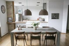 Dining room via Sonoma Seven --- http://sonomaseven.dk/industrial-lamps/